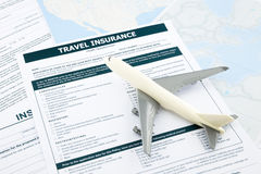 Travel insurance form and   plane model. On world map paperwork, concept and idea for insurance business Stock Photo