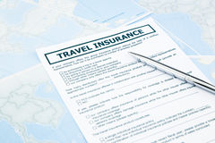 Travel insurance form on world map Royalty Free Stock Photo