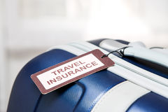 Travel insurance label. Traveler travel insurance tag bag safe suitcase journey concept - stock image Stock Photos