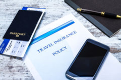 Travel insurance policy. Booklet with a boarding pass and a passport Royalty Free Stock Photo