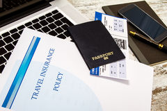 Travel insurance policy. Booklet with a boarding pass and a passport Stock Photo