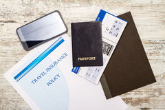 Travel insurance policy. Booklet with a boarding pass and a passport Stock Photography