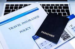 Travel insurance policy. Booklet with a boarding pass and a passport Stock Image