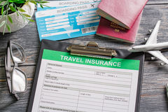 Travel insurance safe background. Travel agent ticket safe plan trip holiday model insurance money concept air form business security paper transportation Stock Photo