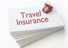 Travel insurance. Small telephone on top of a stack of contact cards with travel insurance Stock Photos