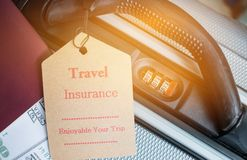 Travel Insurance tag on suitcase near numeric combination lock,. Passport and US Dollar. Travel Insurance is intended cover medical expenses,cover lost luggage Royalty Free Stock Photos