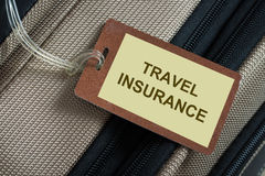 Travel insurance. Tag tied to a luggage Royalty Free Stock Images