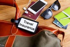 Travel insurance tag on travel bag Royalty Free Stock Photos
