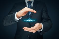 Travel insurance. Concept. Insurance agent or businessman with protective gesture and icon of plane. Quiet Skies by TSA concept royalty free stock image