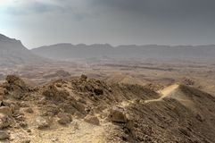 Travel in Israel negev desert landscape. Stone deserts hiking for health and mountain view Royalty Free Stock Photo
