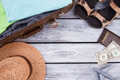 Travel items with copyspace. Flat lay, top view. Wooden desk surface background Royalty Free Stock Image