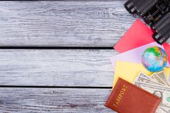 Travel items with copyspace. Top view. Wooden desk surface background Royalty Free Stock Images