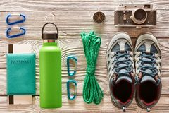 Travel items for hiking flat lay. Travel items for hiking tourism flat lay still life over wooden background Royalty Free Stock Photography