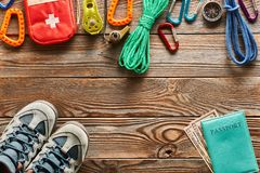 Travel items for hiking over wooden background. Travel items for hiking tourism still life over wooden background Stock Image