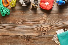 Travel items for hiking over wooden background. Travel items for hiking tourism still life over wooden background Stock Images