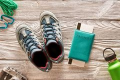 Travel items for hiking over wooden background. Travel items for hiking tourism still life over wooden background Royalty Free Stock Photography