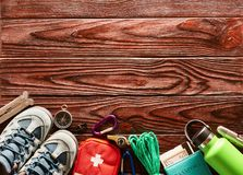 Travel items for hiking over wooden background. Travel items for hiking tourism still life over wooden background Stock Photos
