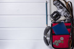 Travel items on wooden rustic table Royalty Free Stock Image