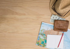 Travel items on wooden table Stock Photos