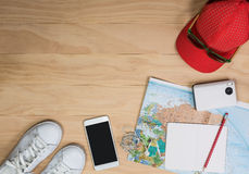 Travel items on wooden table royalty free stock photos