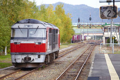 Travel in japan. Japanese red train in sunlight Royalty Free Stock Photos