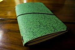 TRAVEL JOURNAL, BRASÍLIA - December 23, 2016: handmade notebook. Green handmade notebook over a table closed royalty free stock photos