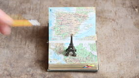 Travel, journey, trip idea or vacation. Map and the Eiffel Tower stock footage