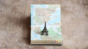 Travel, journey, trip idea or vacation. Map and the Eiffel Tower stock video