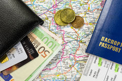 Travel kit. Close-up picture of a passport, wallet, money and map Royalty Free Stock Image