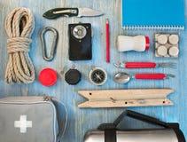 Travel kit modern traveler scout. On blue backpacking royalty free stock photos