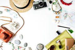 Travel kit: straw, hipster retro camera, map, clutch. Flat lay composition for social media, bloggers and travelers Stock Photo