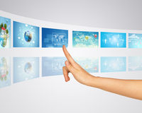 Travel through land. Finger presses one of virtual Stock Photography