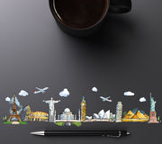 Travel landmarks with cup of coffee and pen Royalty Free Stock Photos