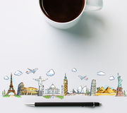 Travel landmarks with cup of coffee and pen. Concept stock photo