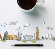 travel landmarks with cup of coffee and pen Royalty Free Stock Image