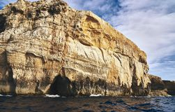 Big rock over the sea royalty free stock photos