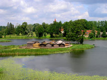 Travel Latvia: Araisi lake dwelling site. View of reconstructed prehistorical Araisi lake dwelling site in North Latvia Stock Photography