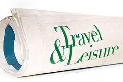 Travel and Leisure, roll of newspapers Royalty Free Stock Photos