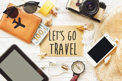 Travel. let`s go travel text sign concept on card flat lay, came Royalty Free Stock Image