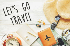 Travel. let`s go travel text sign concept, wanderlust. map camer. A passport money sunglasses and clock hat shells car on white wooden background. hello holiday Royalty Free Stock Photos
