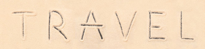 Travel lettering drawn on sand Stock Image