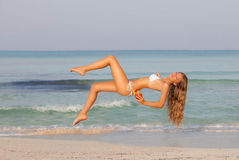Travel levitation concept, woman relaxing on summe. R beach Stock Photography