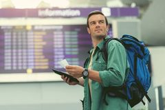 Pleasant man is waiting for flight Royalty Free Stock Images