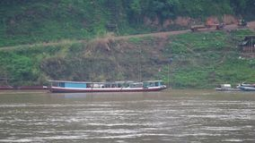 Travel on the local boat in Mekong river stock video