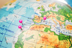 Travel location Islands of Madeira, Tenerife and Mallorca. Pink pins on the globe Royalty Free Stock Image