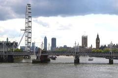 Travel London view. A picture along the River Thames in London with the London Eye, Big Ben, Houses of Parliament and Hungerford railway bridge Stock Photography