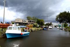 Travel-Louisiana-Shrimp Boats docked and Thunderstorm Clouds Stock Images