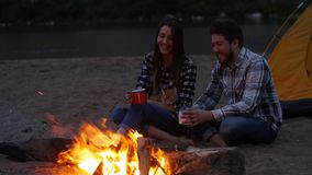 Travel and love concept. Young Lovely couple near fireplace on camp stock video footage