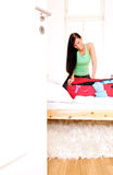 Travel luggage. Scenic woman packing glothes in luggage baggage for holiday Stock Photography