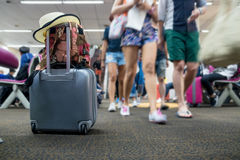 Travel luggage with passenger. Blur background Royalty Free Stock Images